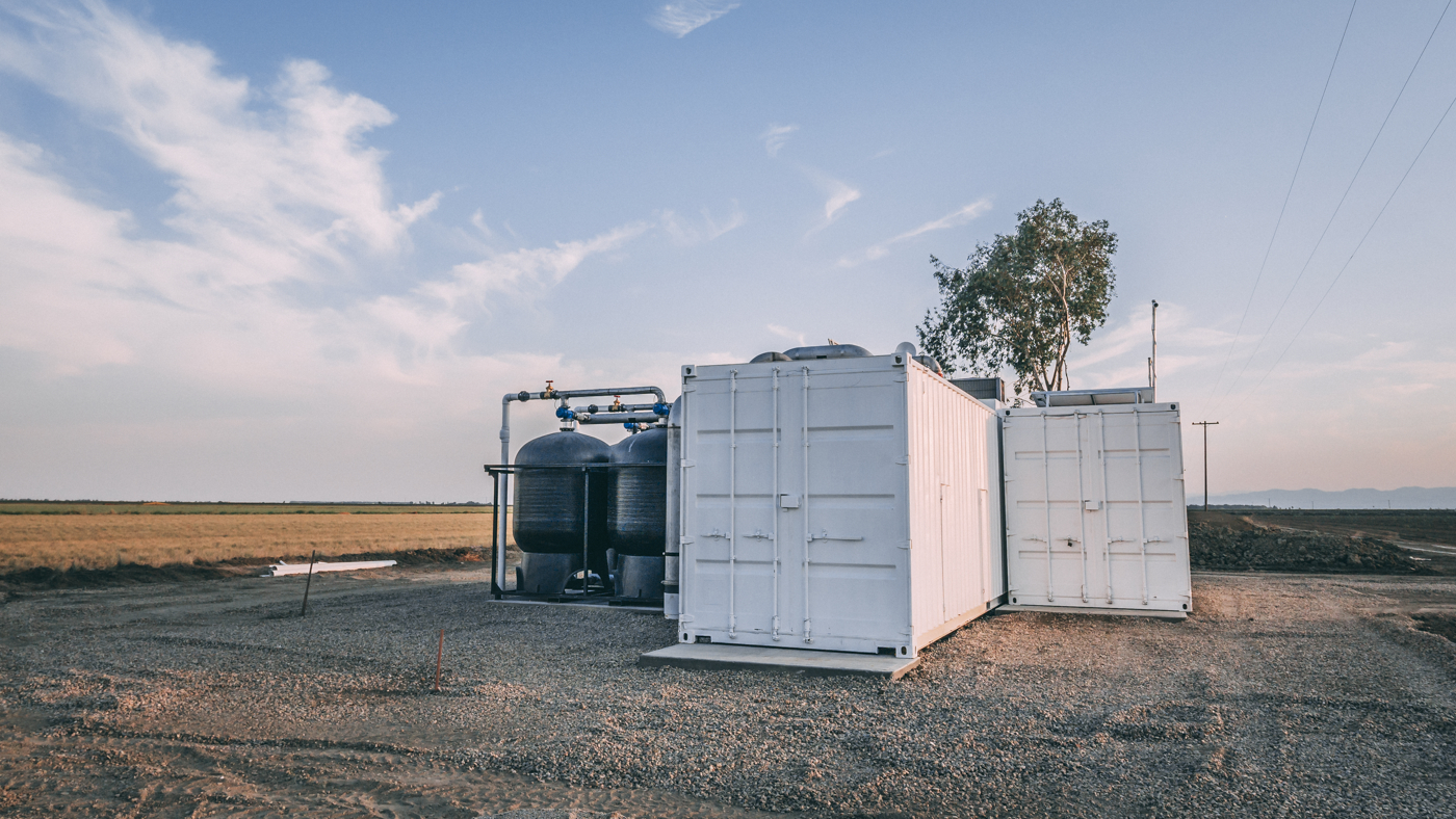 Automated reverse osmosis water purification system located on agricultural land in Central Valley California.